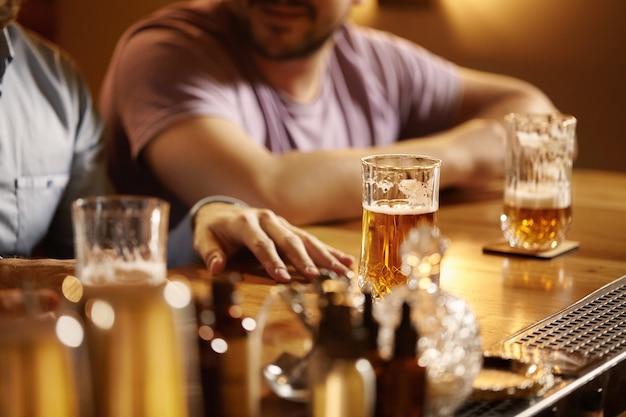 Closeup of pints of beer in bar