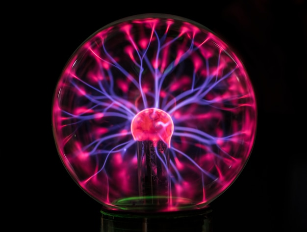 Closeup of a plasma globe in the darkness