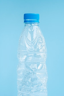 Closeup of plastic bottle on blue background