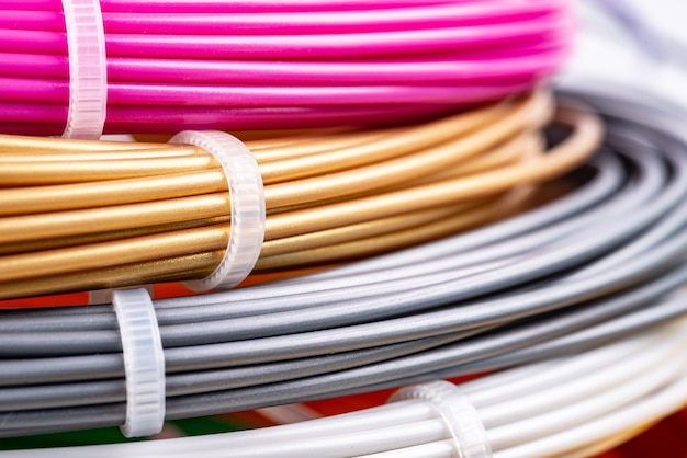 Closeup of plastic bright wires for 3d printer lying indoors