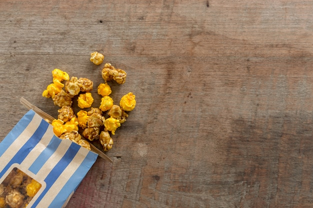 Closeup popcorn on wood table. top view