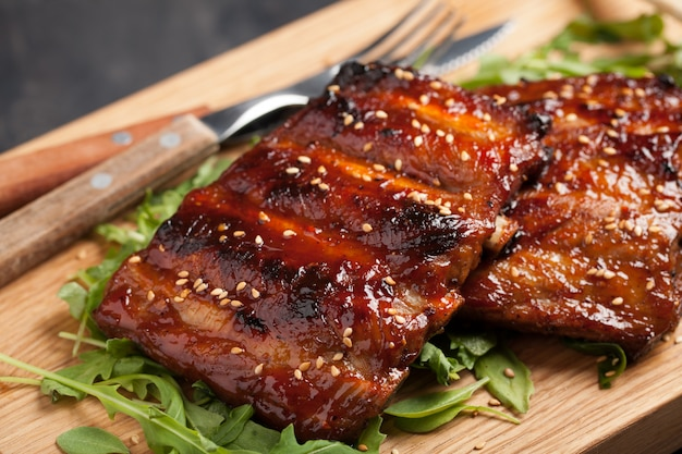 Closeup of pork ribs grilled with bbq sauce.