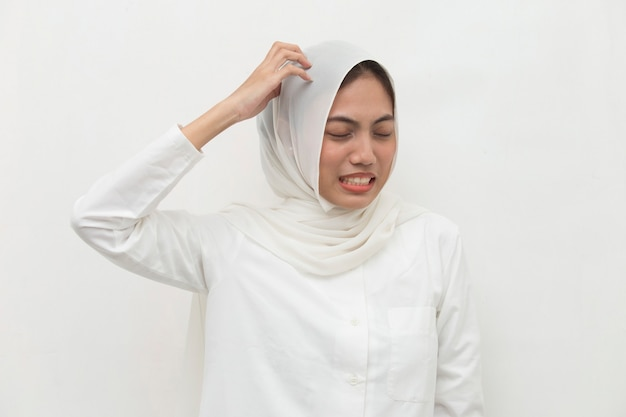 Closeup portrait of asian muslim woman scratching head with hand