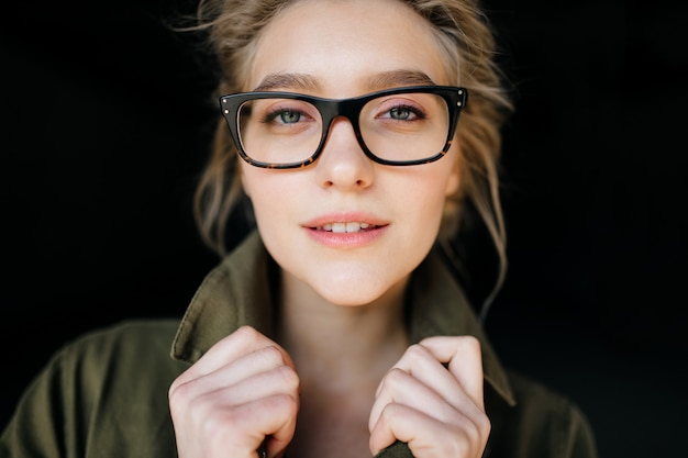 Closeup portrait of attractive young girl in glasses