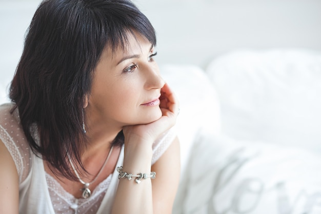 Closeup portrait of beautiful mature woman. mid adult lady indoors. smiling woman. attractive female.