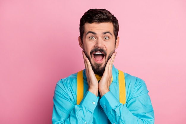 Closeup portrait of cheerful crazy overjoyed guy open mouth