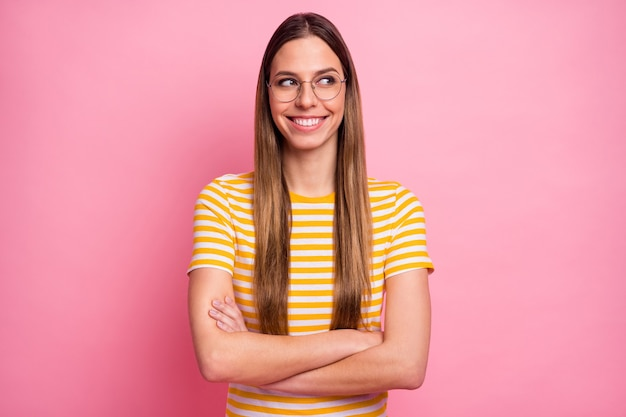 Closeup portrait of curious intellectual girl folded arms think look side