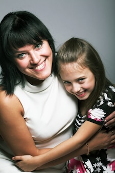 Closeup portrait of cute  girl and her mother