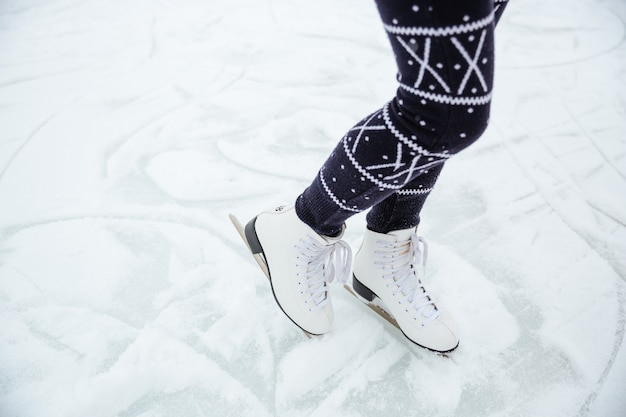 Closeup portrait of a female legs in ice skates