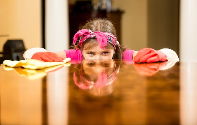 Closeup portrait of girl cleaning house checking table surface