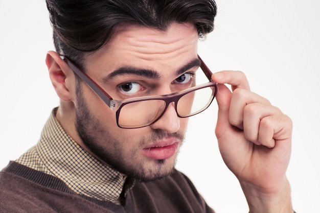 Closeup portrait of a handsome man in glasses  isolated on a white wall