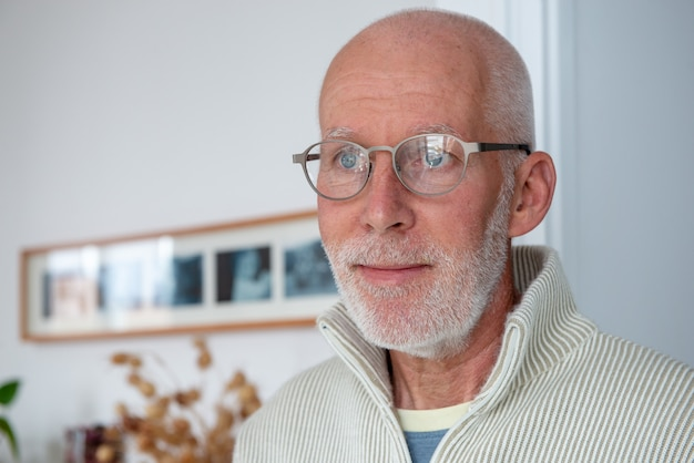 Closeup portrait of happy handsome mature man with glasses