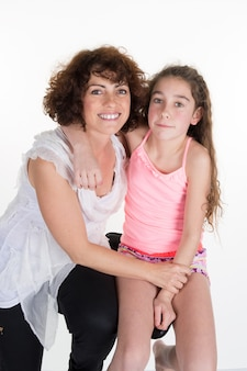 Closeup portrait of happy mother and  daughter - isolated
