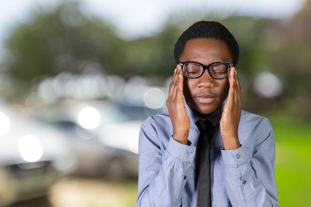 Closeup portrait headshot scared stressed worried, anxious businessman