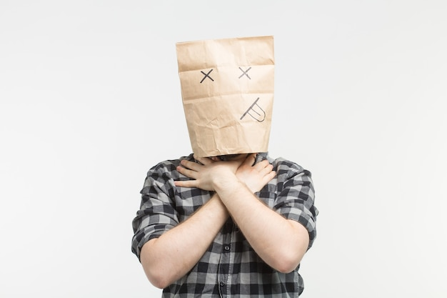 Closeup portrait of men in dead paper bag mask strangle himself