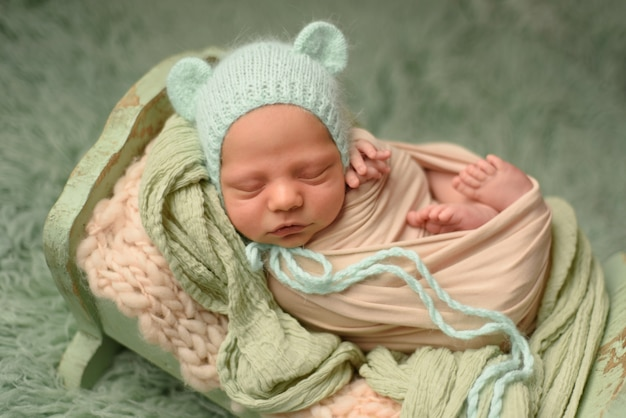 Closeup portrait of newborn baby with smile on face. healthy and medical concept.