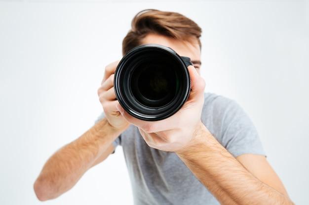 Closeup portrait of photographer making shot on photo camera