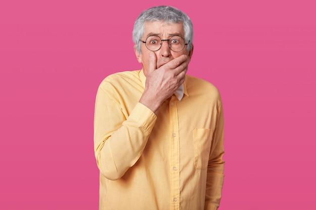 Closeup portrait of scared elderly man with short haistyle.