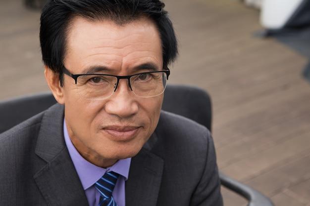 Closeup portrait of serious senior businessman