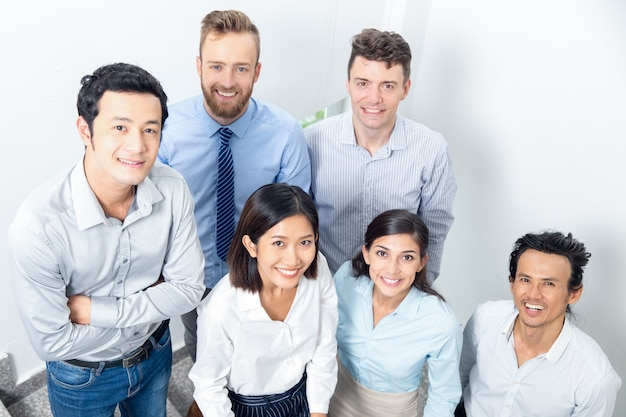 Closeup portrait of smiling business team on stairway