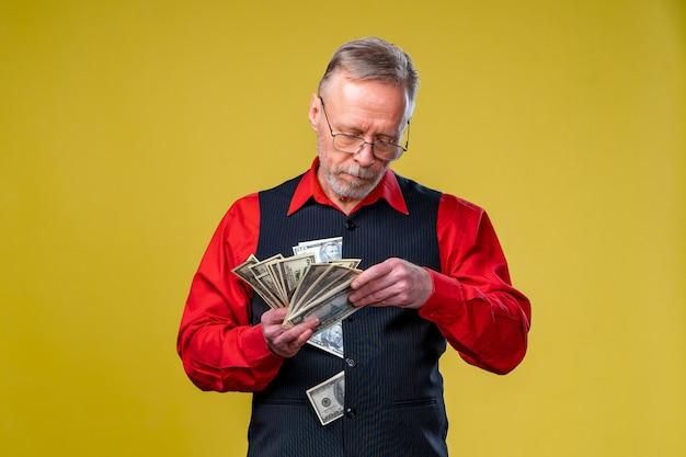 Closeup portrait of super excited senior mature man who just won lots of money