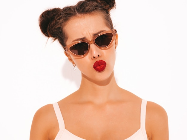 Closeup portrait of young beautiful sexy hipster woman with red lips in sunglasses.