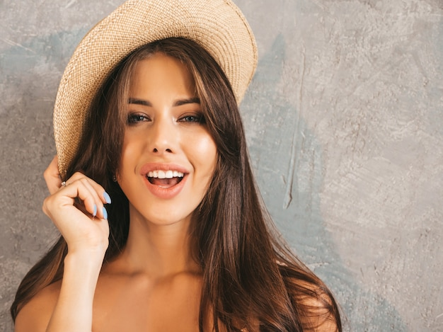 Closeup portrait of young beautiful smiling woman looking . trendy girl in casual. . in hat