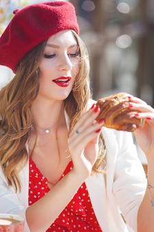 Closeup portrait of young beautiful woman wearing red beret.
