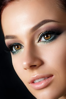 Closeup portrait of young beautiful woman with evening make up