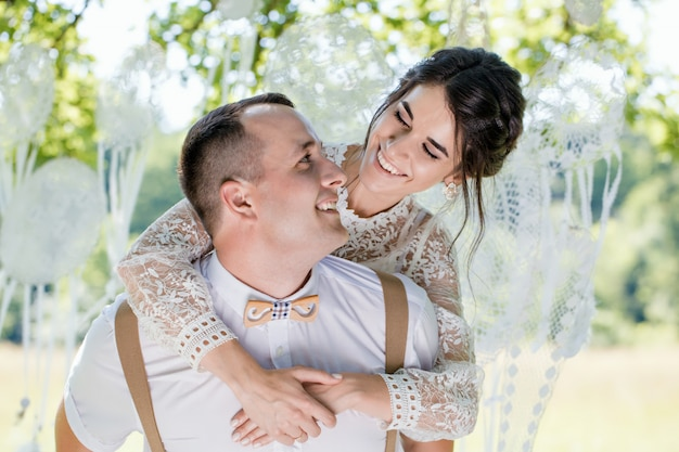 Closeup portrait of a young happy newlywed couple