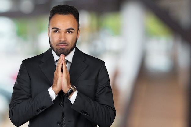 Closeup portrait of young man businessman gesturing pretty please