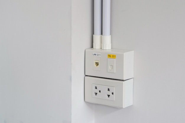 Closeup the power plugs, networks and telephone wall plugs for office and residential.