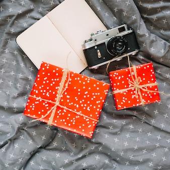Closeup present and camera near notepad