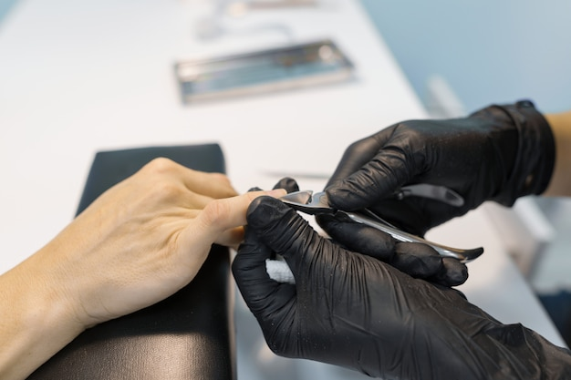 Closeup process of professional manicure