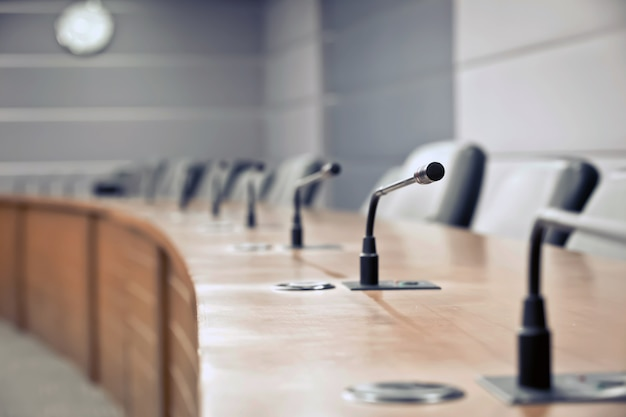 Closeup professional meeting microphone on the table board room