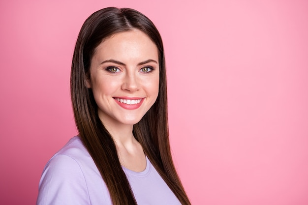 Closeup profile photo of attractive amazing pretty lady good mood smiling teeth charming long hairdo positive expression wear casual violet t-shirt isolated pink pastel color background