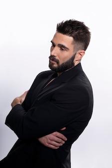 Closeup profile portrait of a confident man posing in black suit
