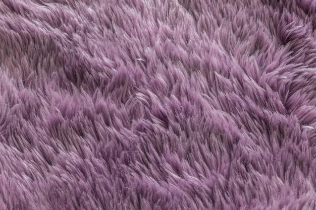 Closeup purple carpet texture background