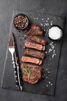 Closeup ready to eat steak new york.