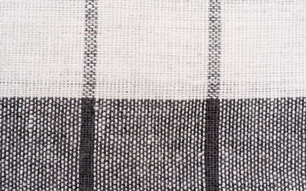 Closeup of a red and white checkered napkin or tablecloth texture isolated for background kitchen