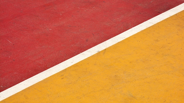 Closeup red and yellow basketball court