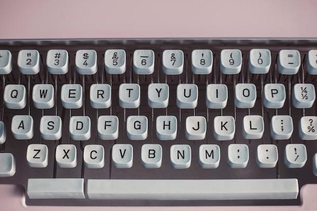 Closeup of a retro pastel pink typewriter