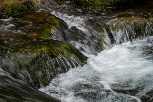 Closeup of the river flow mountain river among large stones