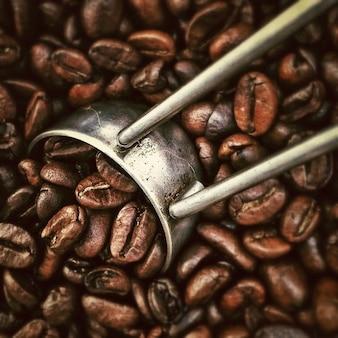 Closeup roasting beverages beans coffee grinder