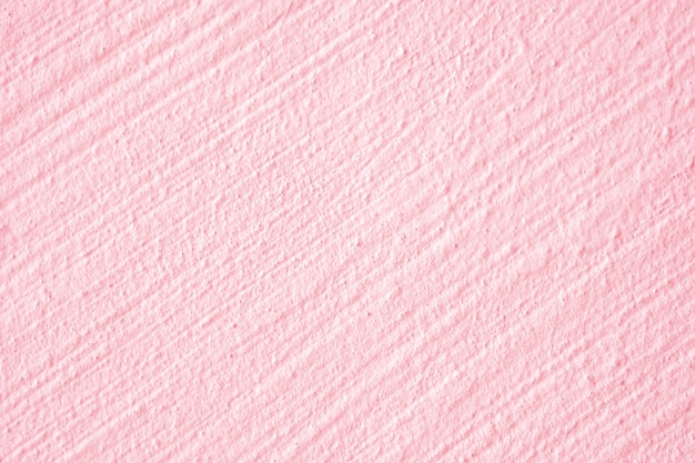 Closeup rough pink patel concrete wall exterior design for texture and background.