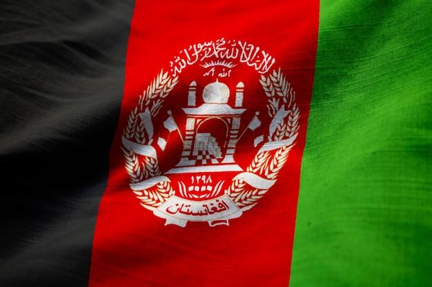 closeup of ruffled afghanistan flag, afghanistan flag blowing in wind
