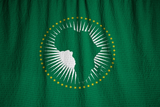 Closeup of ruffled african union flag, african union flag blowing in wind