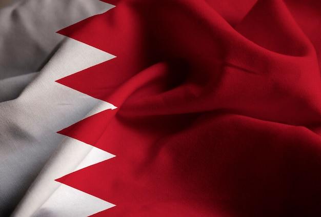 Closeup of ruffled bahrain flag, bahrain flag blowing in wind