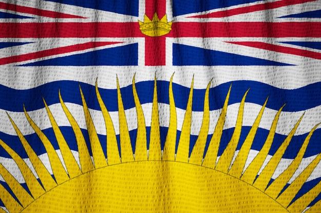 Closeup of ruffled british columbia flag, british columbia flag blowing in wind