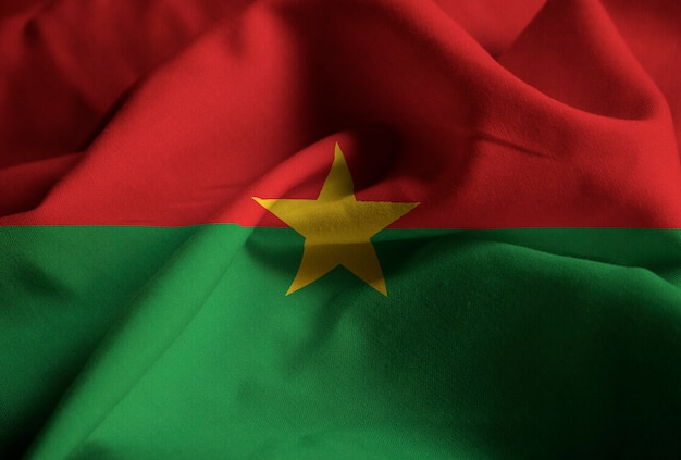 Closeup of ruffled burkina faso flag, burkina faso flag blowing in wind
